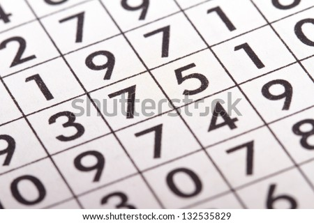 Close up of numbers crossword puzzle. - stock photo
