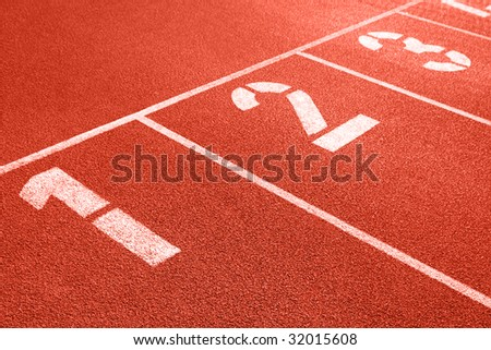 Close up of numbers on red running track. - stock photo