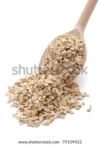 close up of oat flakes in wooden spoon on white background with clipping path - stock photo