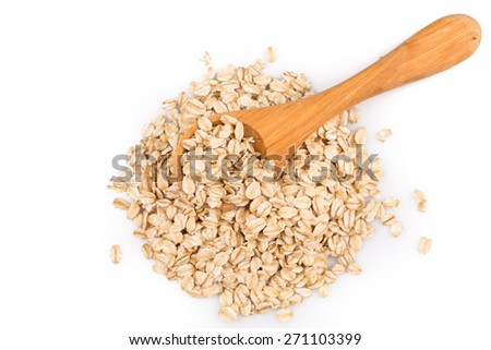 close up of oatmeal flakes in wooden spoon on white background - stock photo