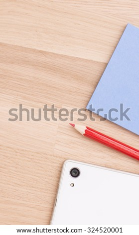 Close up of office desktop with red pencil and blank memo notes. - stock photo