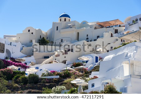 Close up of Oia village from the sea in Santorini island - Greece