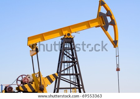 Close-up of oil pump jacks.A pumpjack against blue sky - stock photo