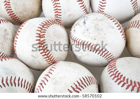 Close up of old baseballs on white background. - stock photo