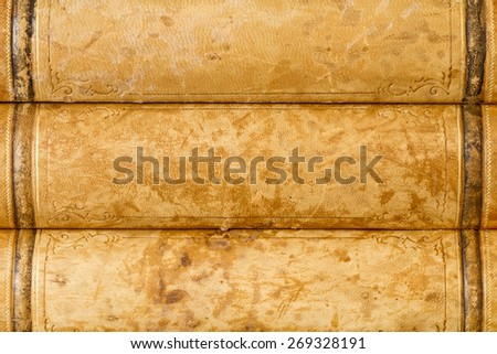 Close up of old books with weathered leather backs - stock photo