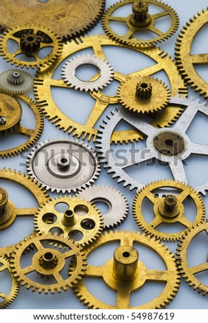 Close up of old brass and steel clock gears with limited depth of field - stock photo