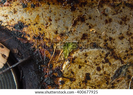 Close up of old broken dirty gas stove in kitchen. - stock photo