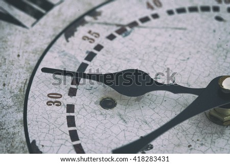 Close-up of old clock with black pointers - stock photo
