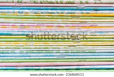 close-up of old colorful notebook spine with staples, background - stock photo