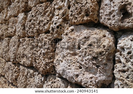 Close-up of old Coral rock wall - stock photo