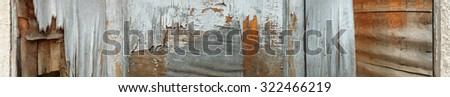 Close-up of old  decaying,peeled and scratched brown and grey wooden surface  - banner, panorama  - stock photo