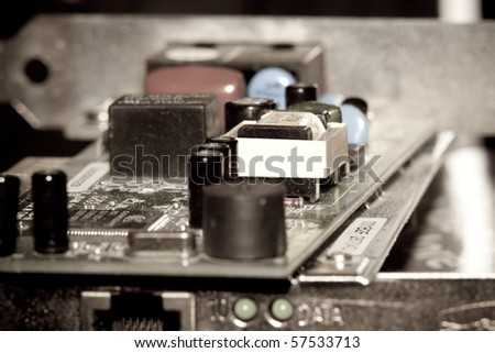 Close up of old, dusty modem and network computer cards - stock photo