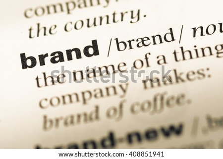 Close up of old English dictionary page with word brand - stock photo