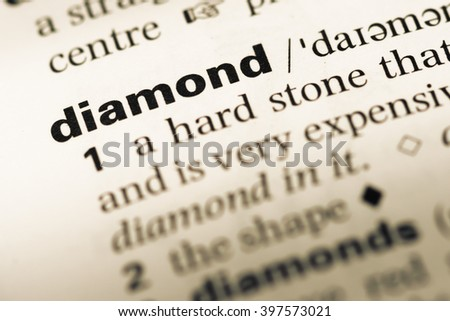 Close up of old English dictionary page with word diamond - stock photo
