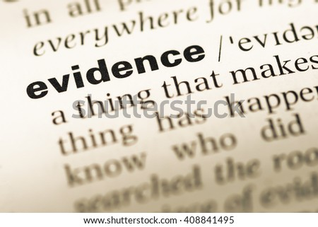 Close up of old English dictionary page with word evidence - stock photo