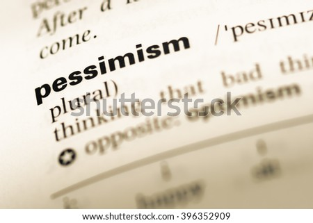 Close up of old English dictionary page with word pessimism