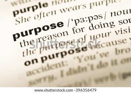 Close up of old English dictionary page with word purpose - stock photo
