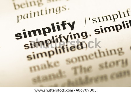 Close up of old English dictionary page with word simplify - stock photo