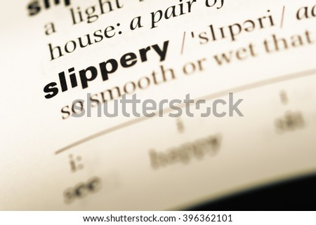 Close up of old English dictionary page with word slippery