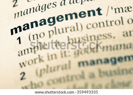 Close up of old English dictionary page with word team - stock photo