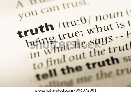 Close up of old English dictionary page with word truth - stock photo