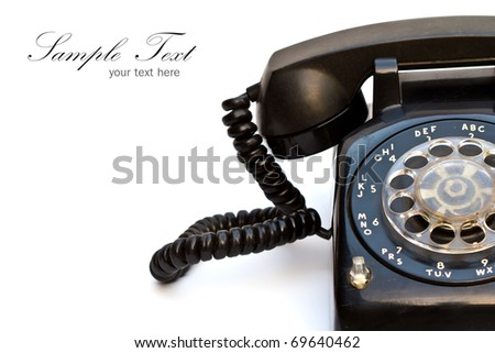 Close up of old-fashioned black telephone with copy space. - stock photo