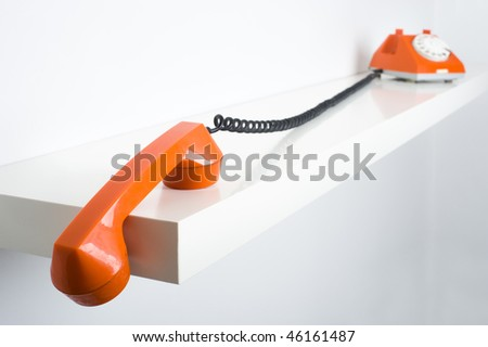 Close up of old fashioned phone hook - stock photo