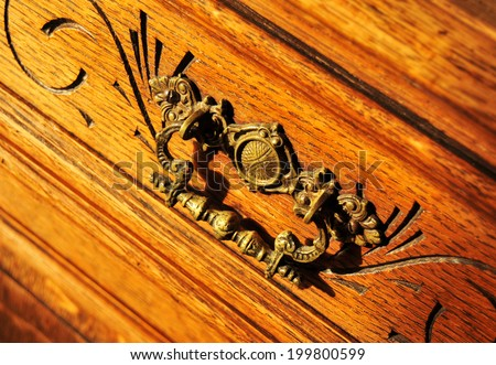 Close up of old furniture with metallic bronze handle - stock photo