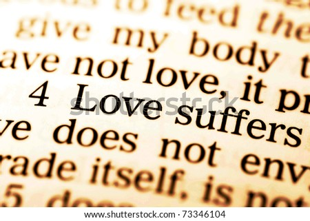 "Close up of old Holy bible book, The word ""Love suffers"". - stock photo"