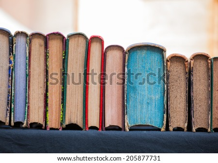 Close up of old Italian books in the street market - stock photo