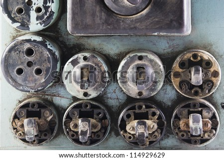 Close-up of old light-switches and sockets