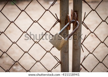 Close up of old lock and a rusty chain on an iron gate - stock photo