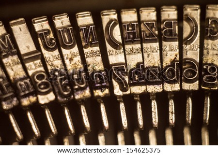 Close up of old metal typewriter letters