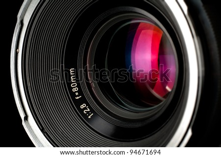 close-up of old photographic lens - some purple/red reflections - stock photo