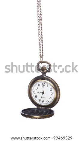 Close-up of old pocket watch isolated on white background