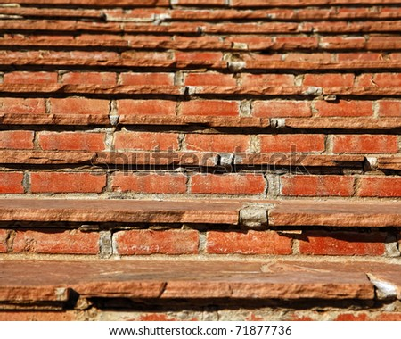 Close up of old red stone and brick steps leading upward � can represent challenges, goals to accomplish in life, moving up, exercise, etc. (shallow depth of field). - stock photo