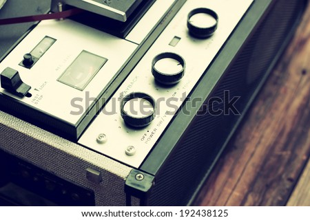 close up of old reel to reel recorder. vintage filtered image - stock photo