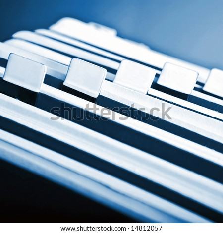 Close-up of old rotary card 12. Blue background - stock photo