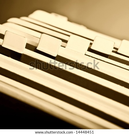 Close-up of old rotary card 11. Sepia background - stock photo