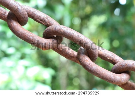 Close up of old rusty metal chain - stock photo