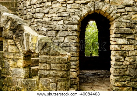 Close up of old Stone Castle with winding stairs, arched room and window. - stock photo