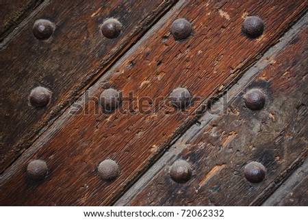Close up of old strong wooden door - stock photo