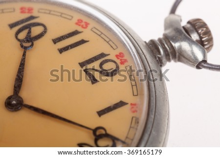 close up of old style pocket watch - stock photo