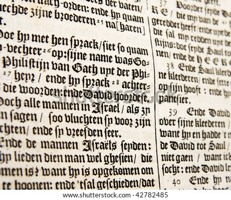 close up of old 17th century Dutch bible passage with shallow depth of field
