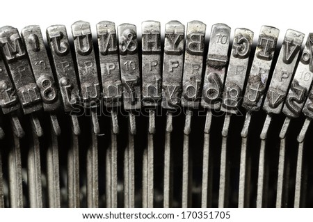 Close-up of old typewriter letter and symbol keys - stock photo