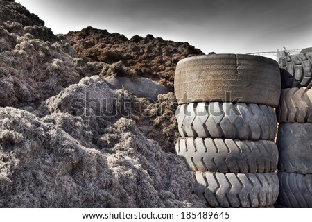 Close up of old used tires and shredded tire pile - stock photo