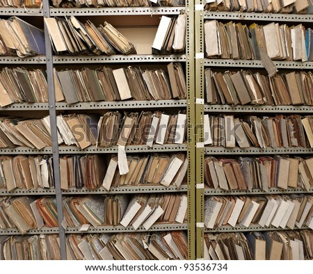 close up of old vintage files in a storage room - stock photo