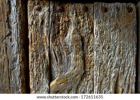 Close-up of old wooden door - stock photo