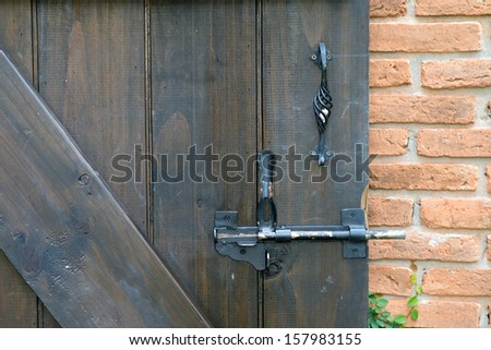 close up of old wooden door and lock