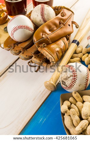 Close up of old worn baseball equipment on a wooden background.